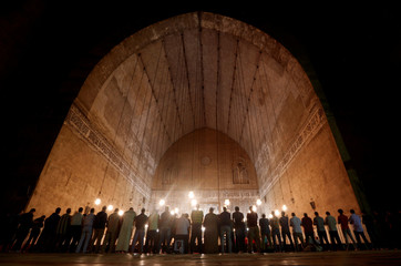 """Egyptian Muslims perform evening prayers called """"Tarawih"""" inside Al Sultan Hassan mosque during the Muslim holy fasting month of Ramadan in the old Islamic area of Cairo"""