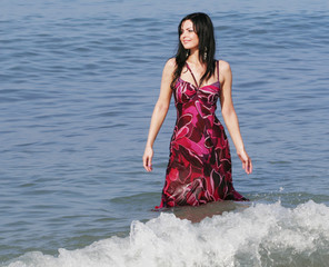 woman standing in sea waves