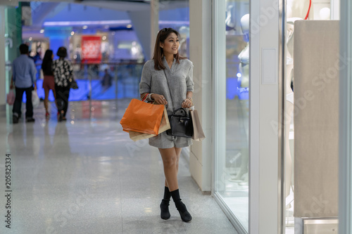 2cb51684c Asian woman walking and looking through the glassess into the underwear on  model display mockup in store shop with happy action at department center
