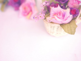 rose bouquet in small basket on white background