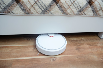robotic vacuum cleaner cleaning the room