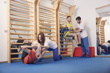 four people, group of people, physiotherapists and patients exercising, physicial therapy.