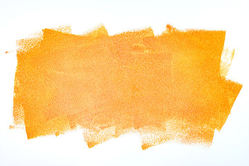 orange paint roller strokes on white wall background