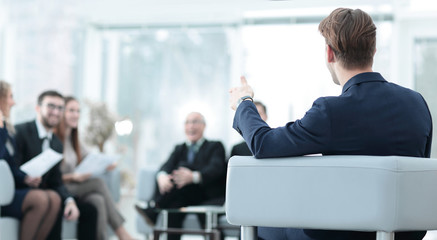 image is blurred.businessman conducting a meeting