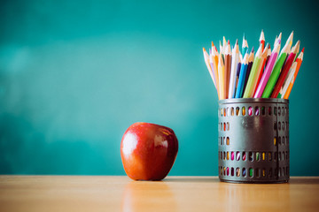 Pencil box apple on the table, the concept of education.