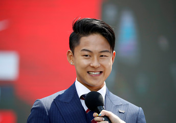 South Korea men's national football team player Lee Seung-woo attends their inaugural ceremony in Seoul