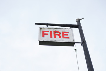 Fire station sign in sky blank post single isolated red white