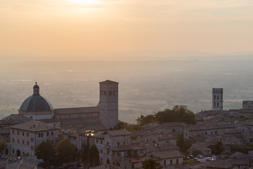 Beautiful and unusual view of Assisi town (Umbria, Italy) at sun