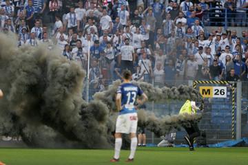 Spectators throw flares during Polish Championship match between Legia Warszawa and Lech Poznan in Poznan
