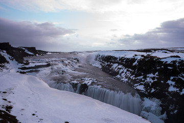 Gullfoss waterfall in the morning one of the most famous waterfall in Icaland / This place is the land of America and Europe are attached