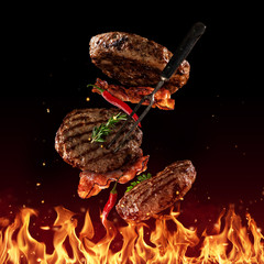 Flying beef minced hamburger pieces on black
