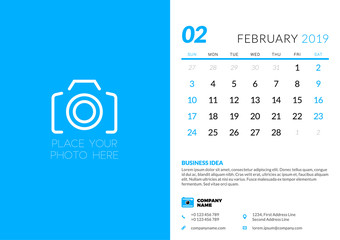 February 2019. Desk calendar design template with place for photo. Week starts on Sunday. Vector illustration