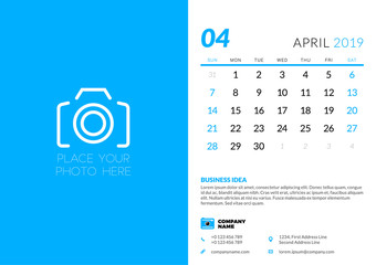 April 2019. Desk calendar design template with place for photo. Week starts on Sunday. Vector illustration