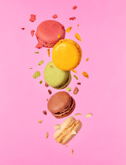 Colored macarons flying in freeze motion