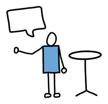 Person an Stehtisch im Gespräch