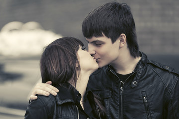 Happy young couple in love kissing outdoor