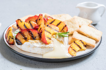 Baked Camembert cheese with grilled peach