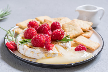 Baked Camembert cheese with raspberry