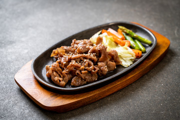 sliced pork steak on hot plate