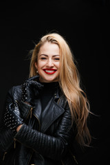 Picture of smiling blonde in leather jacket