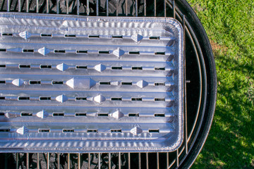 Grill with aluminum trays.
