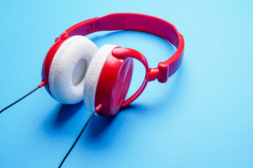Picture of red with white headphones for music close-up