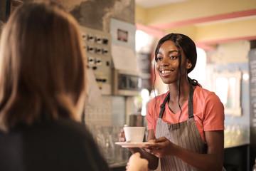 Waitress serving a customer