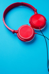 Image of red with white headphones for music from above