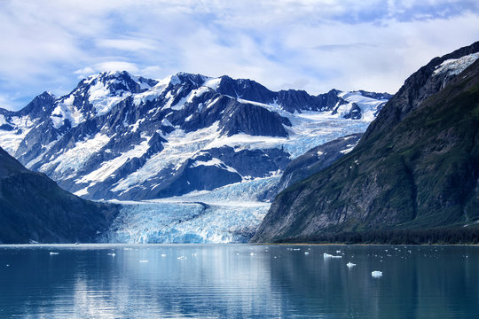 Glacier panorama with ice floes and reflections on the water in Prince William Sound, Alaska, USA