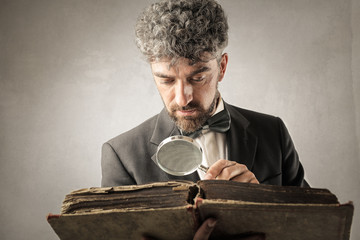 Historian reading an ancient book