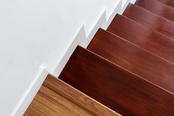 Photo sur Plexiglas Escalier Hardwood stair steps and white wall, interior stairs material and home design