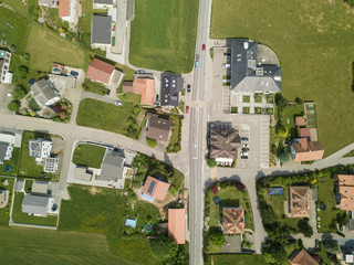 Aerial view of rural village in Switzerland with building and rooftop from above on a beautiful warm summer day