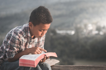 boy reading the scriptures.