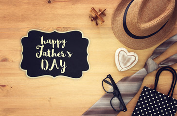 Top view Image of tie and male fedora hat. Father's day concept.