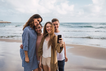 Children taking selfie on sea background