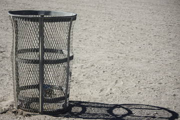 Empty Trash Can at the Beach