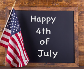 """Happy 4th of July"" Text on a Chalkboard with American Flag"