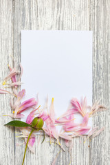 Mockup with postcard and flowers on wooden background