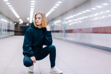 beautiful young blonde girl in an underpass