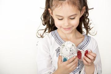 Happy young Muslim girl playing with Ramadan lantern