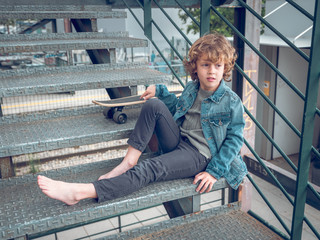 Boy sitting on stairs