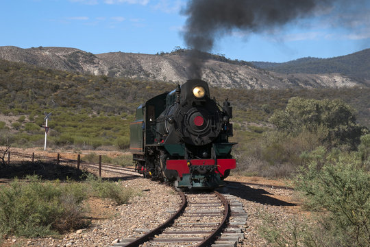 Quorn South Australia, View of approaching restored steam engine with semi arid landscape in background