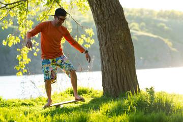 Joyful man is training on the balance board