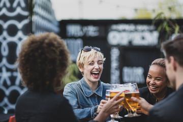 Friends drinking in an outdoor bar in summer