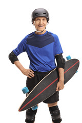 Senior with a longboard and protective equipment
