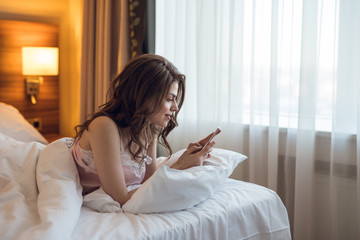Young attractive girl with a phone