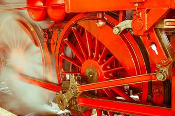 Red wheels of steam locomotive