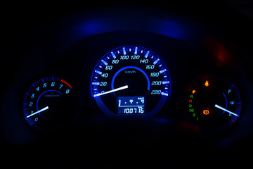 Closeup dashboard of mileage car with  color light