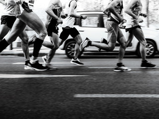 group men runners running street on marathon black-and-white image