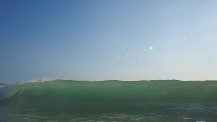 Wall Mural - Slow motion shot of sunset surfing wave in Indonesia at Bali island